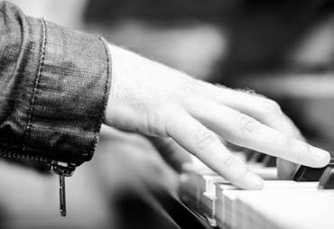 8 Unexpected Benefits of Playing the Piano